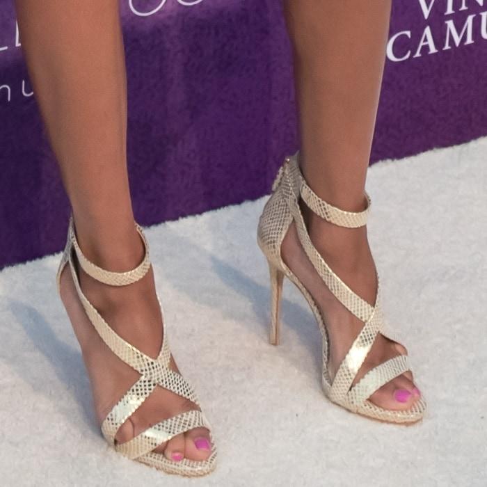 Teala Dunn'sfeet inVince Camuto's 'Devin' sandals