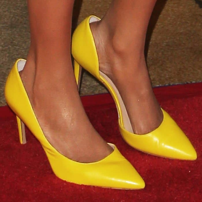 Tyra paired her Stello dress with yellow d'orsay pumps