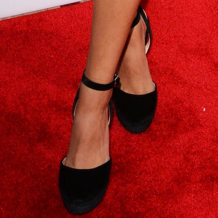 "Victoria towered in a pair of Betsey Johnson ""Alana"" pumps"