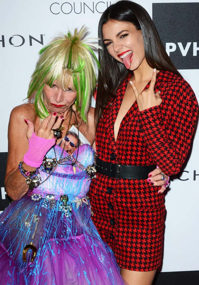 Victoria makes funny poses with the eccentric designer Betsey Johnson