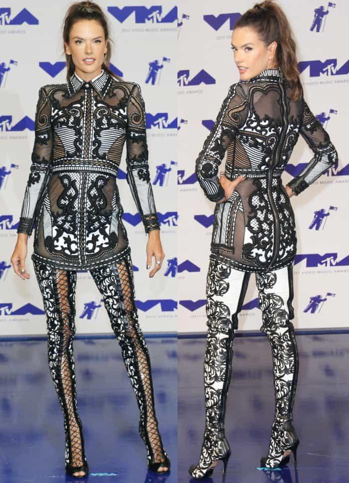 "Alessandra Ambrosio wearing a Balmain Resort 2018 mini dress and ""Campbell"" thigh-high boots at the 2017 MTV Video Music Awards"