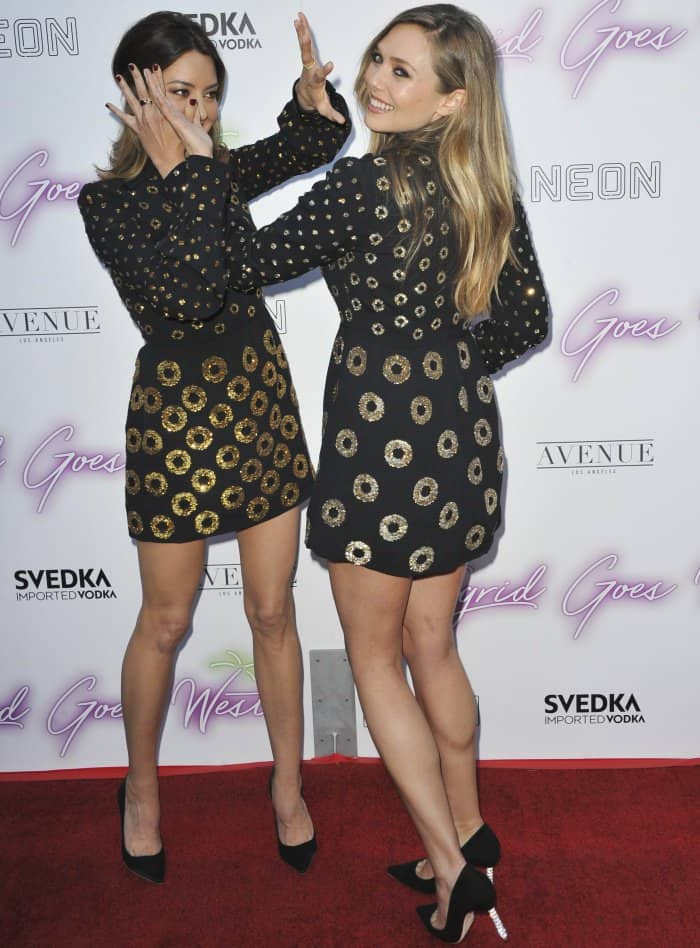 "Aubrey Plaza and Elizabeth Olsen hamming it up for the cameras in matching Marc Jacobs mini dresses and Sophia Webster ""Coco Crystal"" pumps at the LA premiere of ""Ingrid Goes West"""