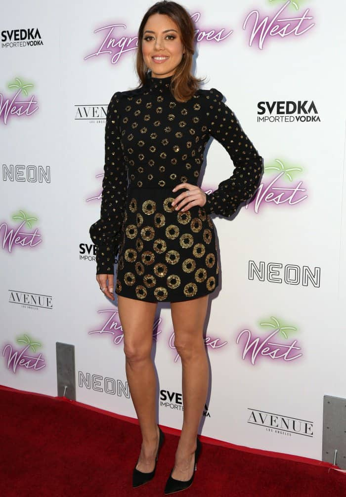 "Aubrey Plaza wearing a black embellished mini dress from Marc Jacobs and ""Coco Crystal"" pumps in black satin from Sophia Webster at the premiere of ""Ingrid Goes West"""