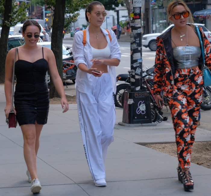 Bella Hadid wearing an all-white ensemble while out and about with friends in New York City