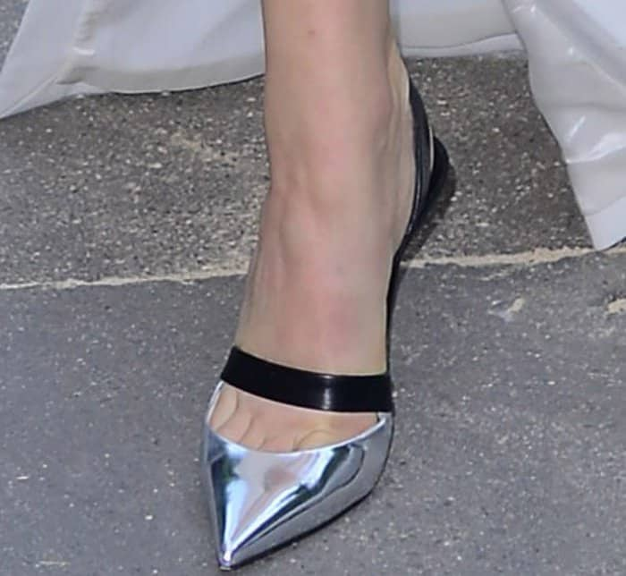 Constance Jablonski wearing silver-and-black slingback pumps at the Vogue Paris Foundation dinner