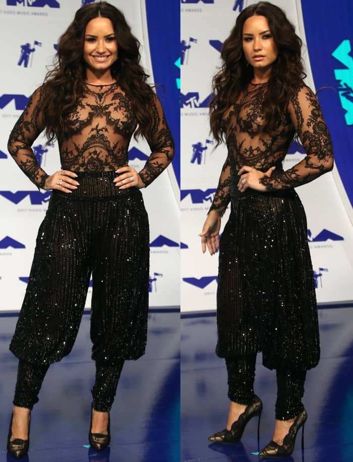 Demi Lovato wearing an all-black Zuhair Murad Fall 2016 Couture ensemble with Casadei lace pumps at the 2017 MTV Video Music Awards