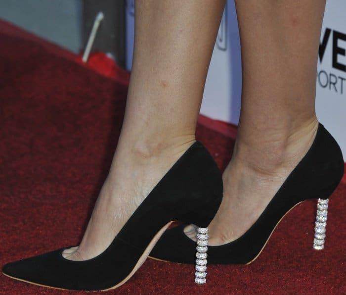 "Elizabeth Olsen wearing black satin ""Coco Crystal"" pumps from Sophia Webster at the LA premiere of ""Ingrid Goes West"""