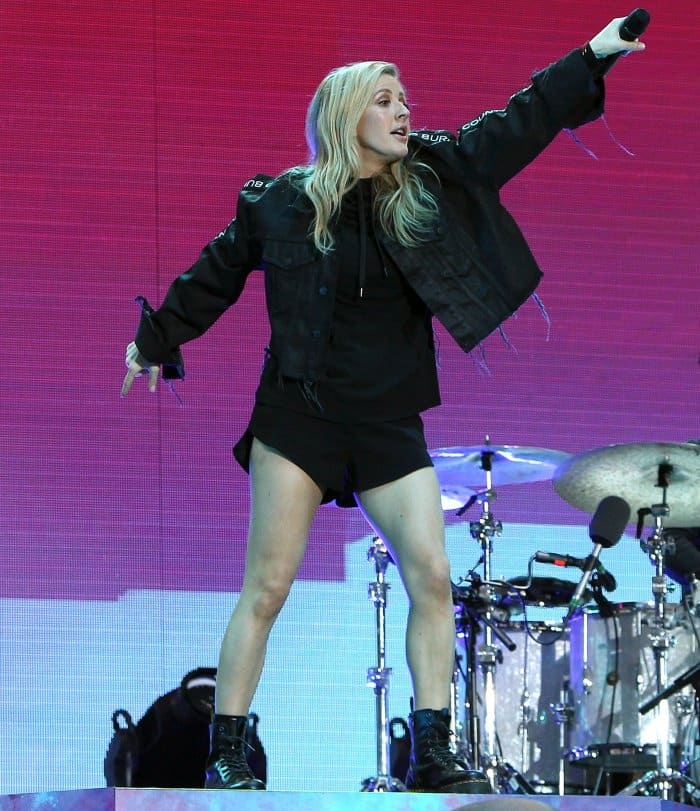"""Ellie Goulding wearing an all-black ensemble with Dr. Martens """"Jadon"""" 8-eye boots during day 2 of the 2017 V Festival"""