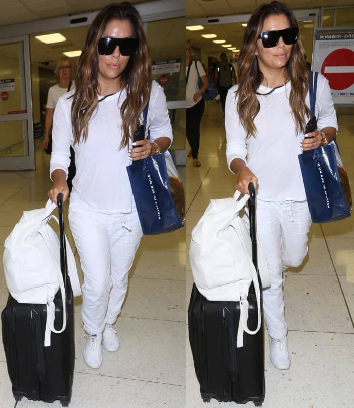 "Eva Longoria arriving at LAX in an all-white ensemble styled with Adidas Originals ""Stan Smith"" sneakers"
