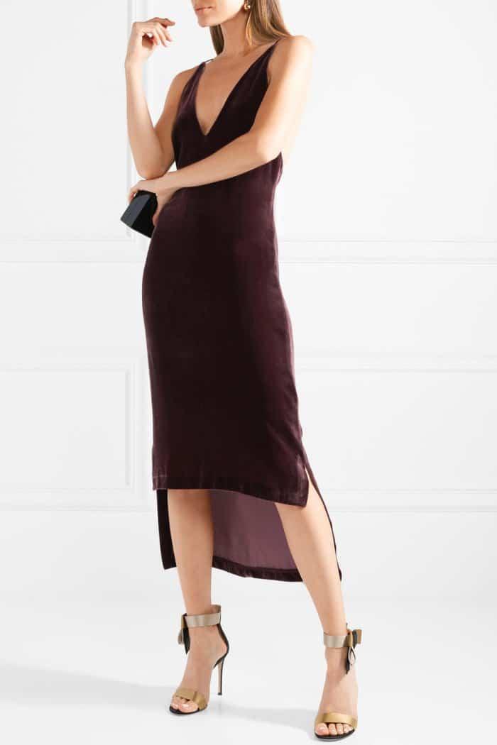 "Model wearing the Gianvito Rossi ""Geisha"" sandals with the Dion Lee merlot velvet asymmetric midi dress"