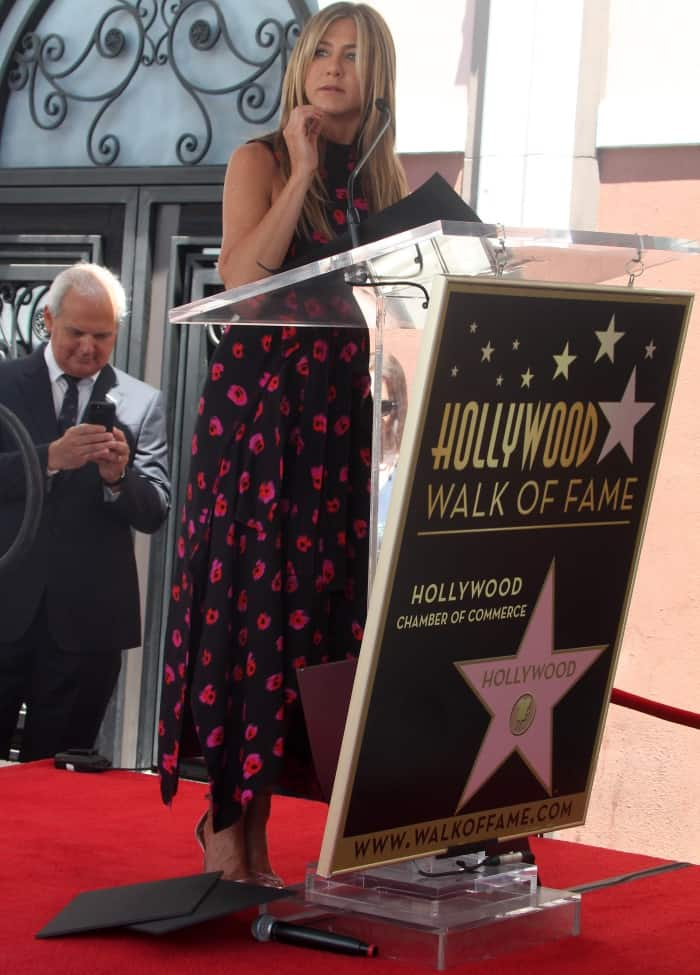 """Jennifer Aniston wearing a Proenza Schouler Pre-Fall 2017 printed georgette dress and Aquazzura """"Purist"""" velvet sandals at the Hollywood Walk of Fame Star ceremony honoring Jason Bateman"""