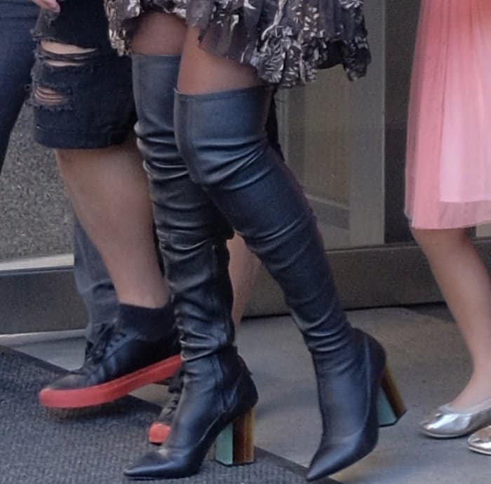 Jessica Alba'sfitted thigh-high boots from Zimmermann feature pointy toes, zip closures at inner seams and multicolored Perspex heels