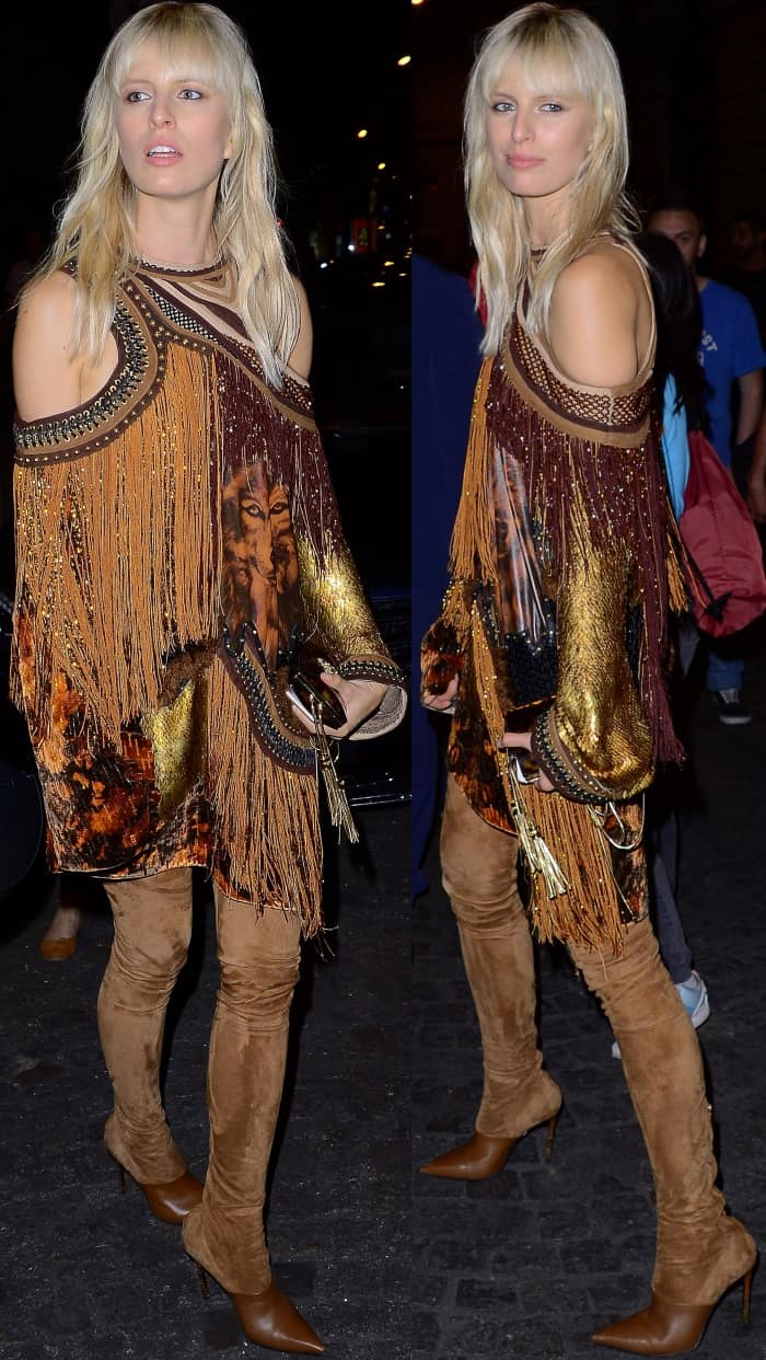 Karolina Kurkova wearing a Balmain cold-shoulder dress and brown suede legging boots at the Vogue Paris Foundation dinner