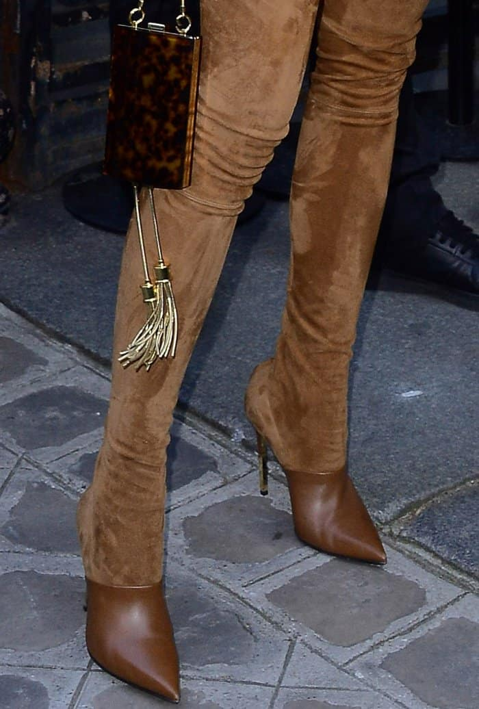 Karolina Kurkova wearing brown suede legging boots at the Vogue Paris Foundation dinner