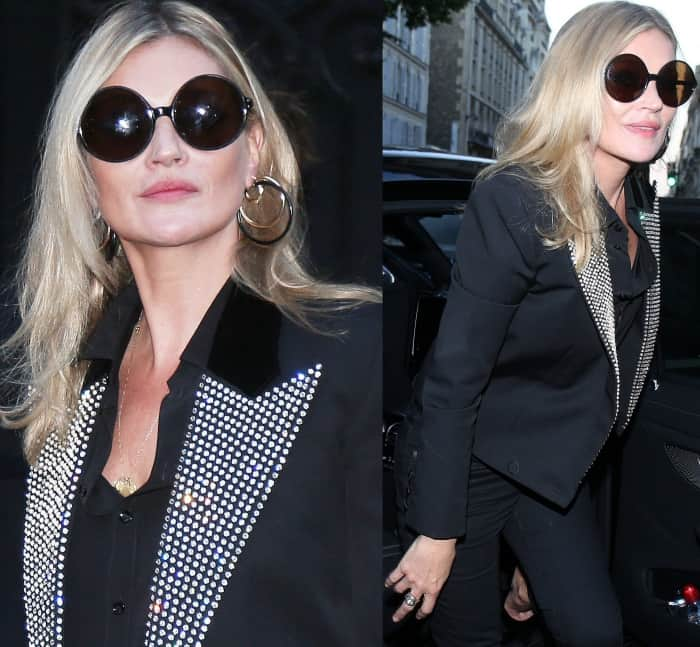 Kate Moss wearing a Saint Laurent by Anthony Vaccarello blazer, black top, and black denim pants at the Vogue Paris Foundation dinner