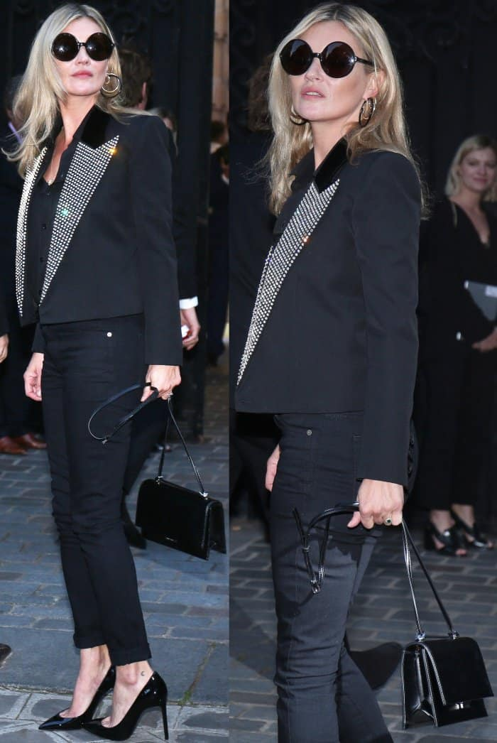Kate Moss wearing a Saint Laurent by Anthony Vaccarello blazer, black top, black denim pants, and black pointy-toe pumps at the Vogue Paris Foundation dinner
