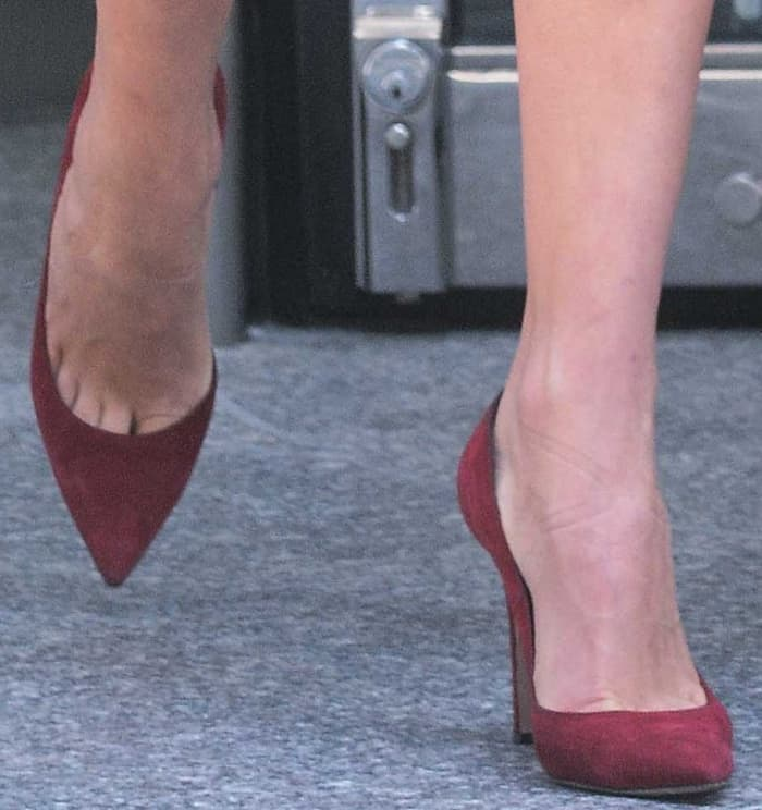 Lily Donaldson wearing red suede pumps while out and about in New York City