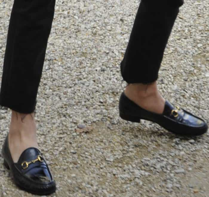 Lily Donaldson wearing black Gucci loafers before the Balmain Fall/Winter 2017 show during Paris Fashion Week