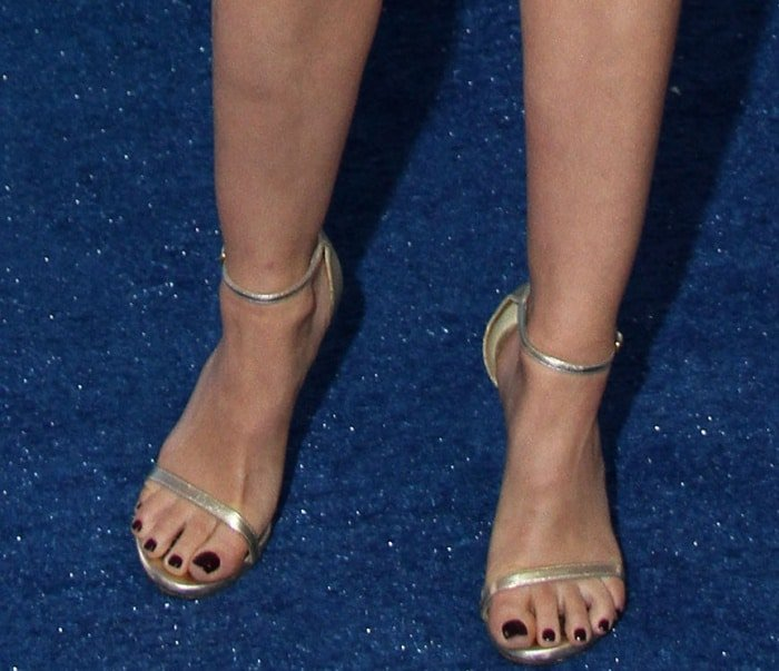 "Lucy Hale wearing pale gold Stuart Weitzman ""Nudist"" sandals at the 2017 Teen Choice Awards"