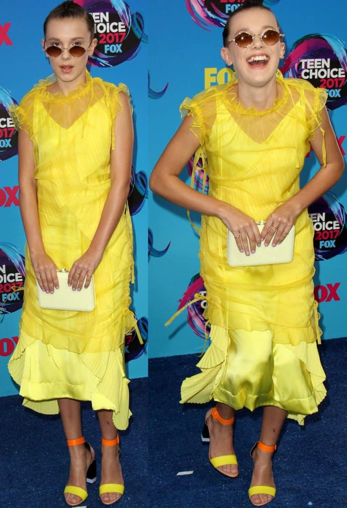 Millie Bobby Brown's yellow Kenzo dress with ruffle details and a tulle overlay