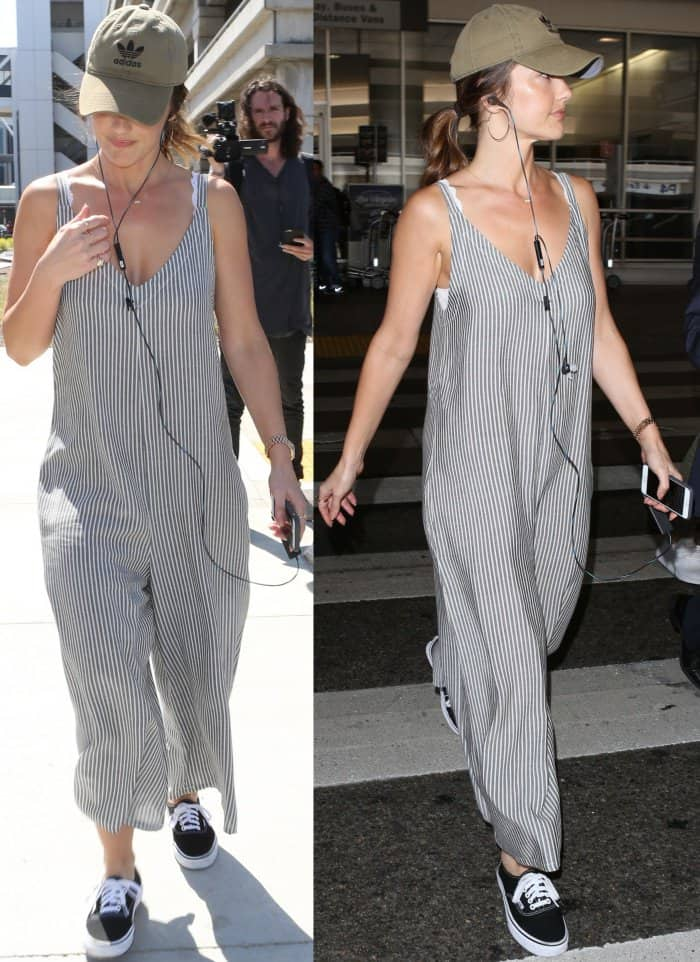 "Minka Kelly arriving at LAX in an oversized striped jumpsuit and Vans ""Authentic"" sneakers"