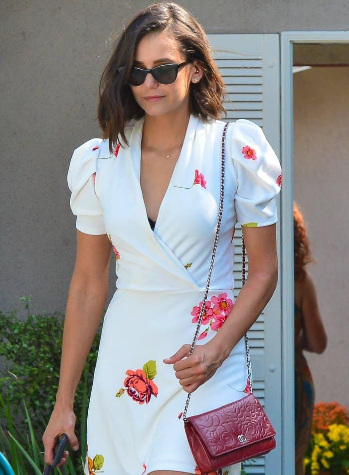 Nina Dobrev with a side-swept bob and Garrett Leight sunglasses
