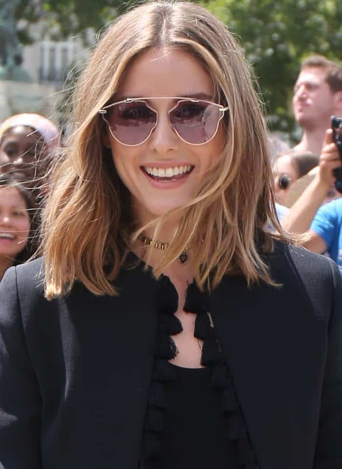 "Olivia Palermo wearing a black tassel jacket and Dior ""So Real Pop"" sunglasses at the Christian Dior Fall/Winter 2017 show during Paris Haute Couture Fashion Week"
