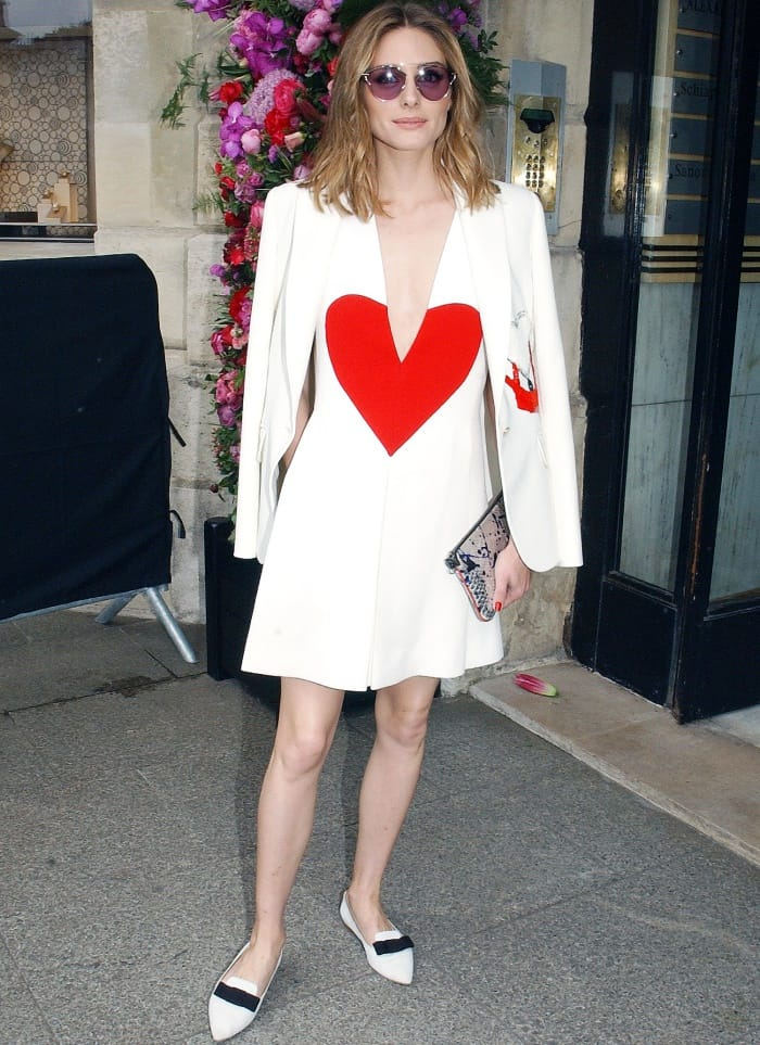 """Olivia Palermo wearing a Schiaparelli Spring 2017 Couture dress and Jimmy Choo """"Gala"""" flats at the Schiaparelli Fall/Winter 2017 show during Paris Haute Couture Fashion Week"""