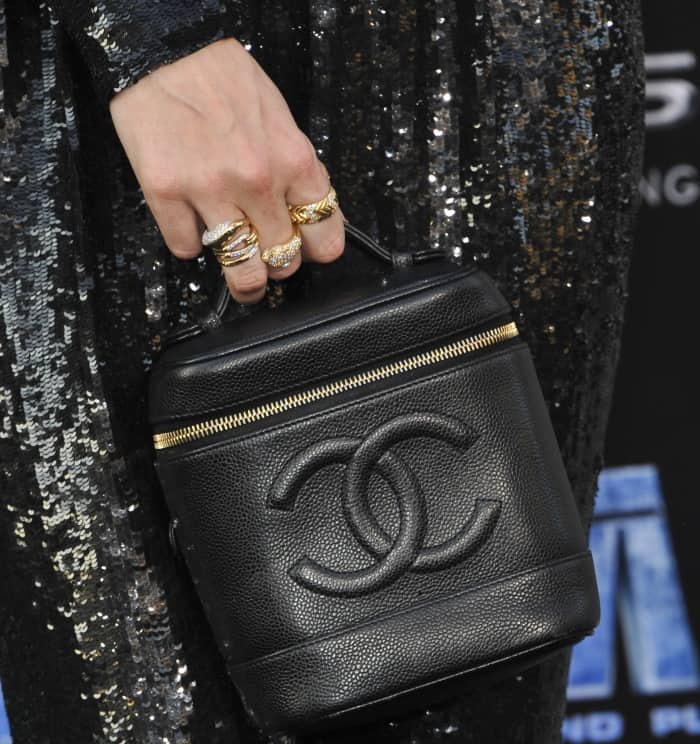 "Poppy Delevingne carrying a black Chanel logo bag at the LA premiere of ""Valerian and the City of a Thousand Planets"""
