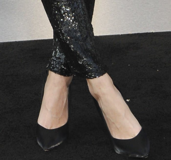 """Poppy Delevingne wearing Giuseppe Zanotti black silk pointy-toe pumps at the LA premiere of """"Valerian and the City of a Thousand Planets"""""""