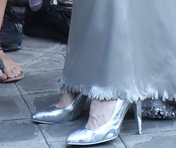 Tilda Swinton wearing metallic silver pumps at the Vogue Paris Foundation dinner