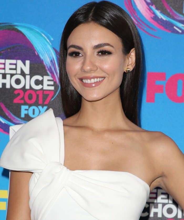 Victoria Justice wearing a Nicolas Jebran Spring 2017 jumpsuit at the 2017 Teen Choice Awards