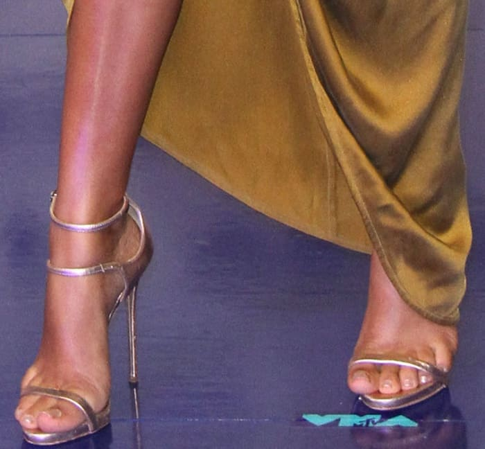 Yara Shahidi's feet in rose gold heels from Giuseppe Zanotti