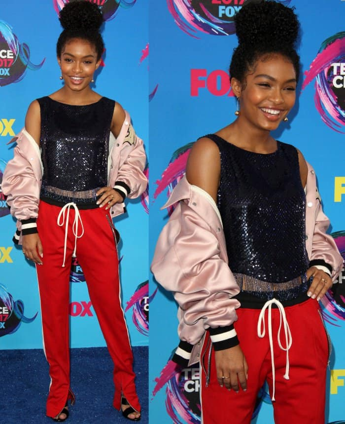 "Yara Shahidi wearing a Fear of God bomber jacket, Libertine sequined top, red-and-white track pants, and Giuseppe Zanotti ""Francesca"" sandals at the 2017 Teen Choice Awards"
