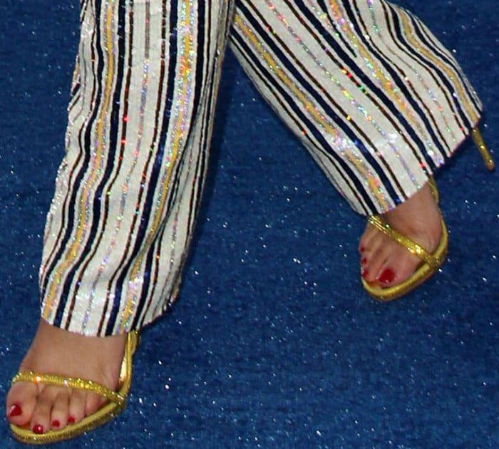 "Zendaya wearing gold Le Silla ""Crystals"" sandals at the 2017 Teen Choice Awards"