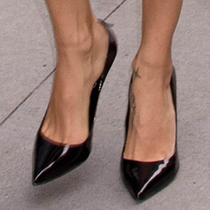 """Adriana keeps things simple with a pair of Schutz """"Farrah"""" patent pumps"""
