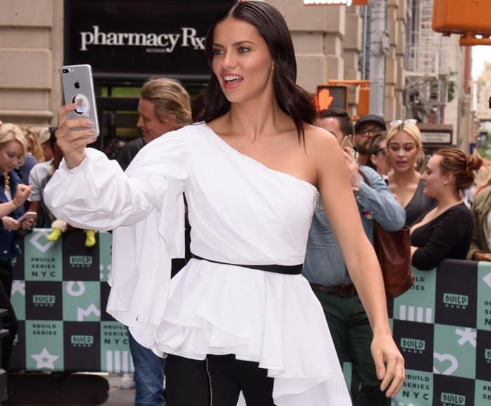 Adriana looked angelic in a ruffled top by Johanna Ortiz