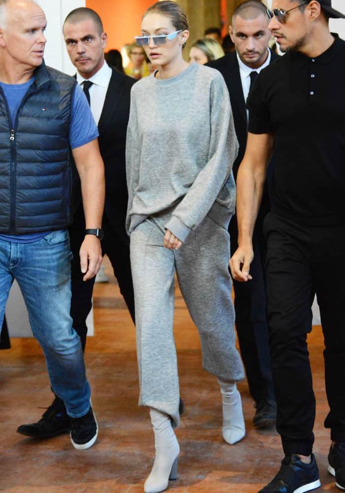Gigi exits the show in an all-gray ensemble