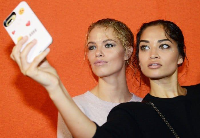 Hailey Clauson and Shanina Shaik pose for a selfie