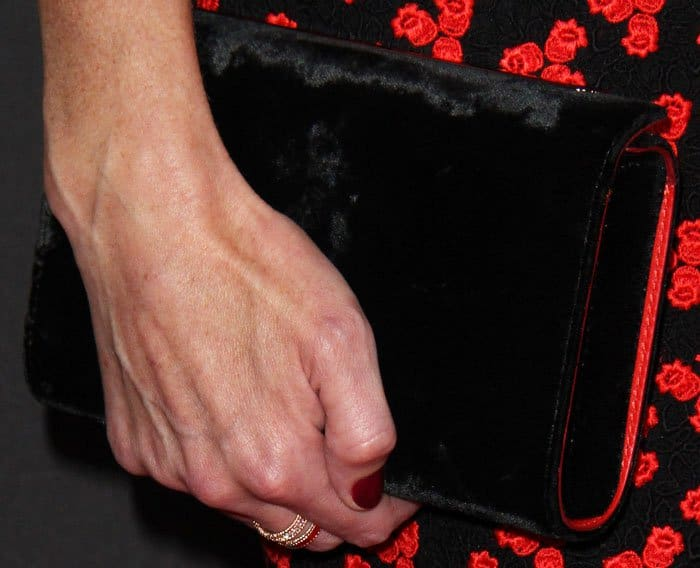 Velvety goodness: Alexis complements her dress with a Christian Louboutin clutch