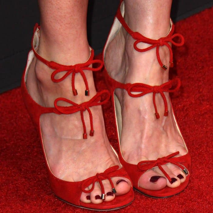 Alexis softens her look with a pair of Jimmy Choo front tie sandals