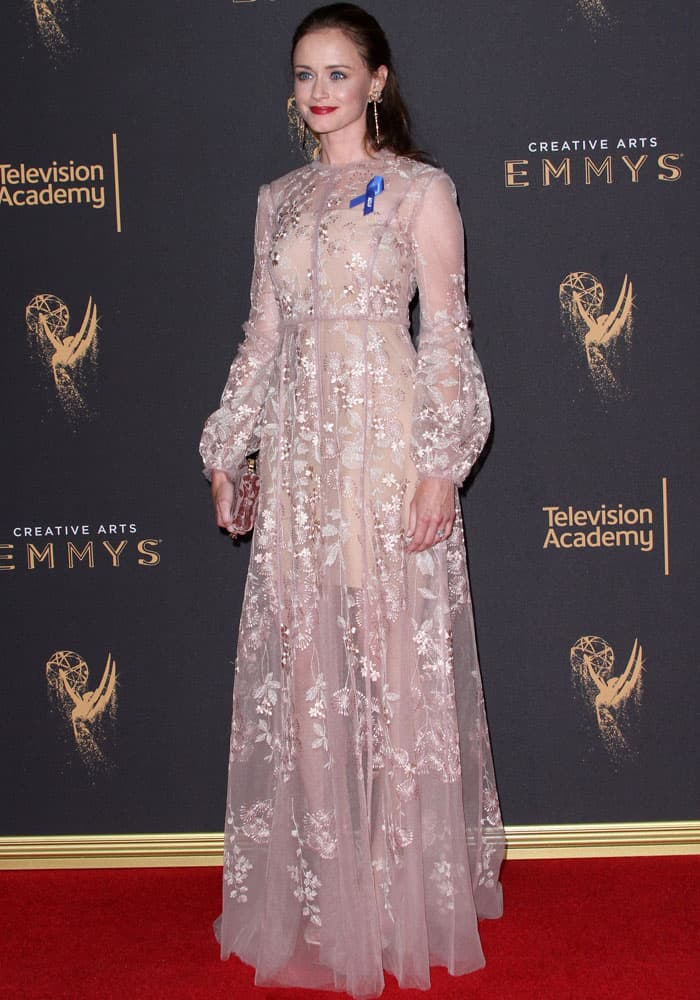 Alexis stunned in a whimsical J. Mendel embroidered dress