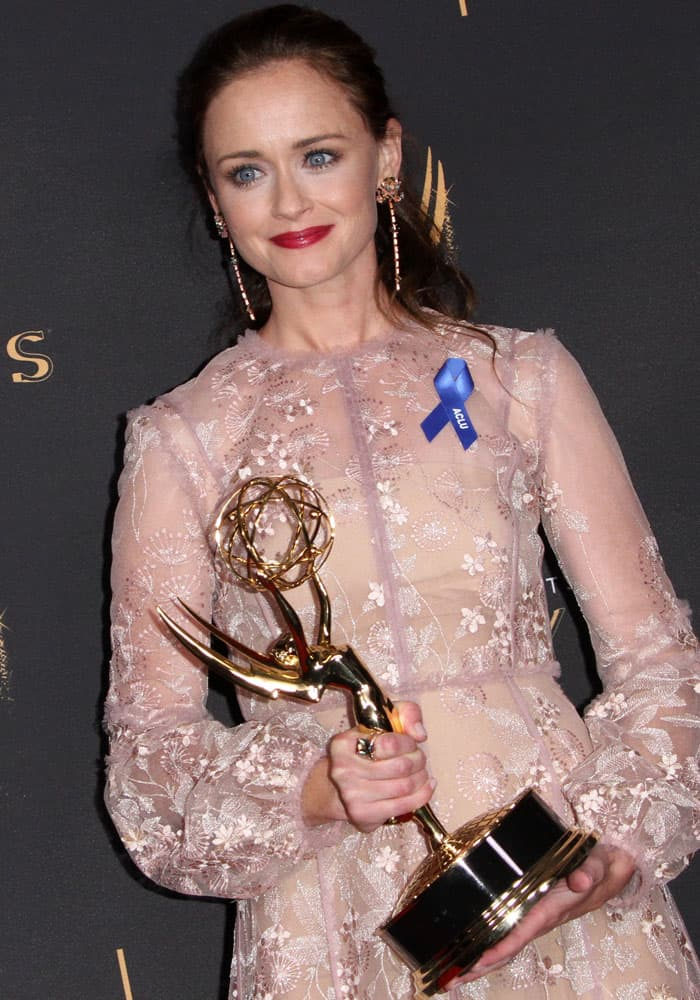 Alexis admits to being emotional over her first Emmy win