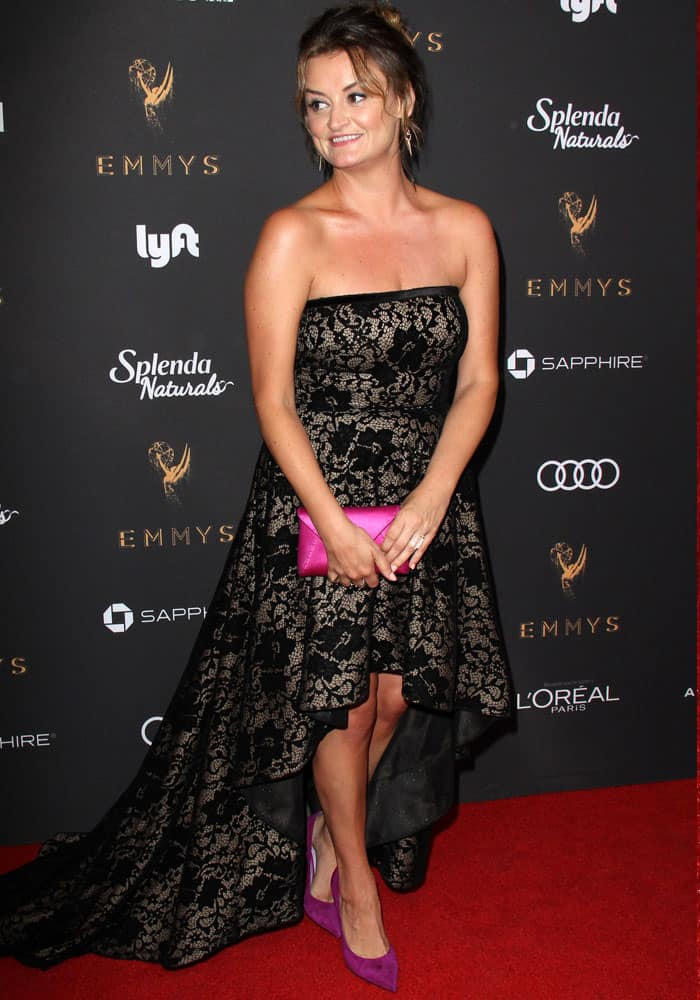 Alison Wright wears a lace Tadashi Shoji to the red carpet