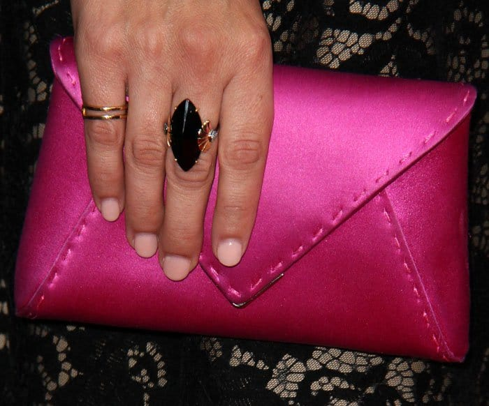 The actress mismatches with a silk Tyler Ellis clutch