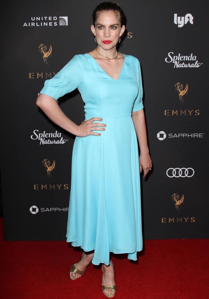 Anna Chlumsky wears a mint blue dress