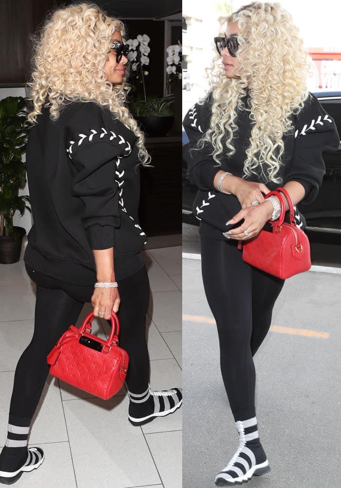 Chyna wore an all-black ensemble as she traveled leisurely to Atlanta