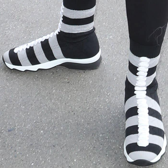 Chyna wore a pair of the quirky Fendi sock sneakers in gray and black