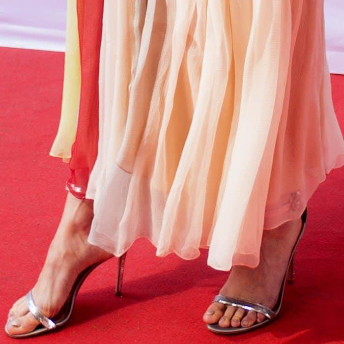 Brie Larson showing off her tortured feet in metallic ankle-strap heels