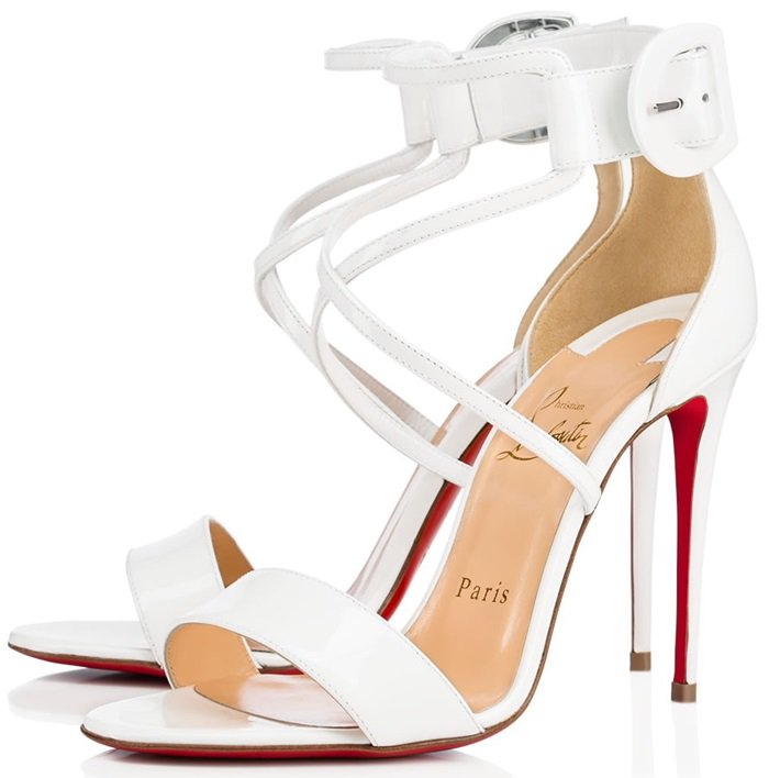 Elevated on a 100mm stiletto heel, this pair in latte patent leather is an understated beauty